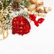 Christmas composition with red bauble, golden decorations, gift — Stock Photo