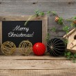 Vintage christmas decoration with blackboard and balls — Stock Photo #34984189