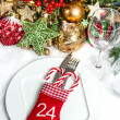 Festive table setting with christmas tree decoration — Stock Photo