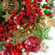 Baubles, golden garlands, christmas tree and red berries — Stock Photo #34984379