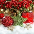 Baubles, golden garlands, christmas tree and red berries branche — Stock Photo