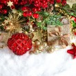 Baubles, golden garlands, christmas tree and red berrie — Stockfoto