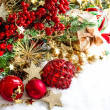Baubles, golden garlands, christmas tree and red berries — Stock Photo #34985031