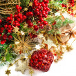 Baubles, golden garlands, christmas tree and red berries — Stock Photo #34985073