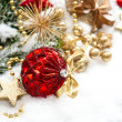 Christmas composition with red balls und golden decoration — Stock Photo #34985429