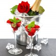 Champagne, red rose and strawberries over white — Stock Photo