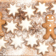Gingerbread man cookie, cinnamon stars and star anise — Stock Photo