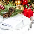 Festive christmas table place setting with red and gold decor — Stock Photo #34986595