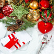 Christmas table place setting with red heart candle — Stock Photo #34986603