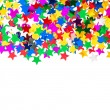 Star shaped red, blue, green, gold confetti — ストック写真