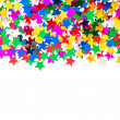 Star shaped red, blue, green, gold confetti — Stock Photo