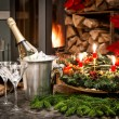 Stock Photo: Bottle of champagne, glasses and fireplace