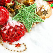 Christmas decoration with red baubles and shiny green star — Стоковая фотография