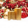 Christmas decoration with candles, baubles, red berries — Stock Photo