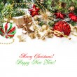 Decorations in red, gold green with christmas tree branches — Stock Photo