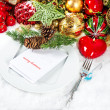 Christmas table place setting decoration with red candle — Stock Photo