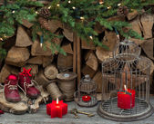 Vintage style christmas decoration with red burning candles — Stock Photo