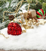Christmas composition with red balls und golden decoration — Stockfoto