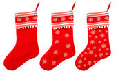 Red christmas sock with white snowflakes for Santa gifts — Stock Photo
