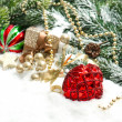 Christmas composition with red balls und golden decoration — Stock Photo