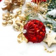 Stock Photo: Christmas composition with red baubles and golden decoration