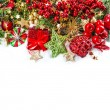 Baubles, golden garlands, christmas tree and red berries — Stock Photo