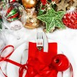 Christmas table place setting with red and gold decorations — Stock Photo #34993149