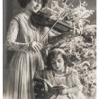 Antique portrait of mother and daughter with christmas tree — Stock Photo