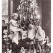 Happy kids with christmas tree, gifts and vintage toys — Stockfoto