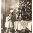 Antique photo of littele girl with christmas tree and vintage to — Photo