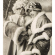 Two young girls in vintage winter clothing. christmas postcard — Stock Photo