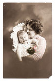 Antique portrait of lucky mother with her cute baby — Stock Photo