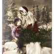 Nostalgic christmas postcard. two kids with chtistmas tree — Stock Photo #35920843