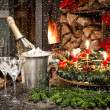 Bottle of champagne, glasses and fireplace — Stockfoto
