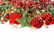 Baubles, golden garlands, christmas tree and red berries — Foto de Stock