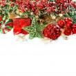 Baubles, golden garlands, christmas tree and red berries — Stok fotoğraf