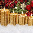 Advent decoration with four burning golden candles — Stock Photo