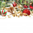 Festive christmas decorations in red, gold, green — Stock Photo