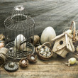 Vintage easter decoration with eggs, birdhouse and birdcage — Zdjęcie stockowe