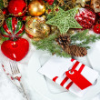 Christmas table place setting with red heart candle — Stock Photo