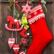 Christmas decoration stocking and handmade toys — Stock Photo