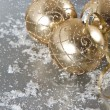 Stock Photo: Golden christmas balls with snow decoration
