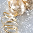 Stock Photo: Golden christmas balls with golden streamer and snow decoration