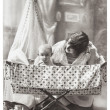 Antique family portrait of mother and baby — Stock Photo