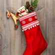 Christmas stocking with nostalgic vintage toys decoration — Stock Photo #36323667