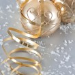 Stock Photo: Golden christmas balls with golden streamer and snow