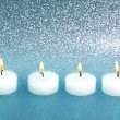 Burning candles over silver blue shiny background — Stock Photo #36323991