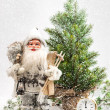 Santa Claus with christmas tree in snow — Stock Photo
