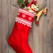 Christmas stocking with nostalgic vintage toys decoration — Stock Photo