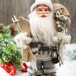 Stock Photo: SantClaus with christmas tree in snow